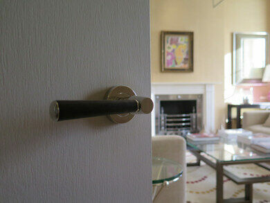 "Leather wrapped ""Turnstyle"" lever handle c/o Somerset Place, Bath"